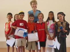 Children receiving 'virtues awards' at end of year Assembly.